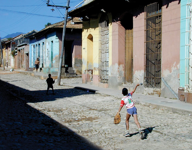 The Cubans are crazy for baseball, and it's the game the kids play in the street  Santiago da Cuba, January 2001