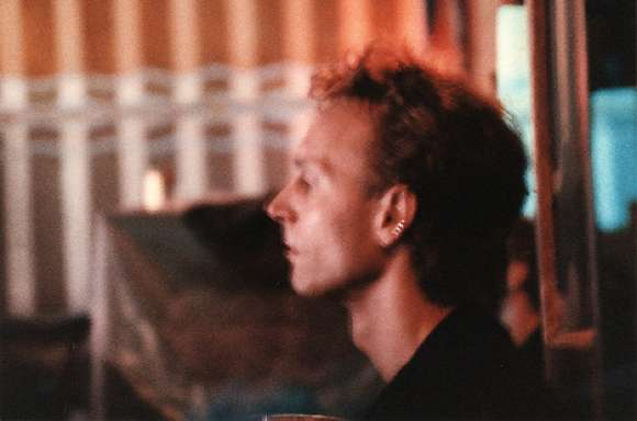 Listening animatedly at CBGB's in  New York, c1994  photo: JR Rost