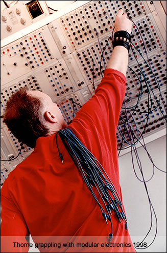 Mike Thorne grappling with modular electronics, 1998