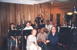 Jimmy in studio with musicians