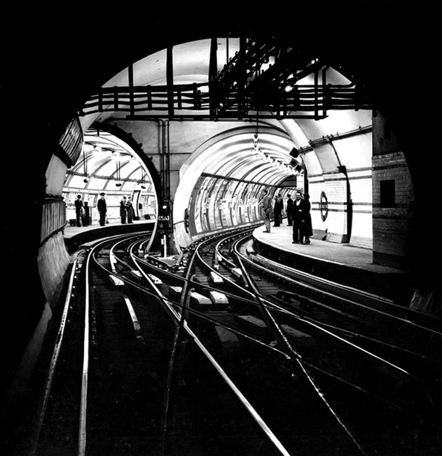 photo: Heinz Zinram courtesy London's Transport Museum © Transport For London Bakerloo Line platforms at Piccadilly Circus Underground Station, London, June 22 1954.