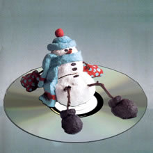 The snowman sits on a CD...