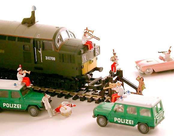 Locomotive: British Railways, English Electric Type 3 (built 1962) Emergency vehicles: German, Car: T Bird Personnel: Confused, Scale: HO; photo: Molesworth,