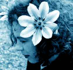 Sarah Jane Morris with flower in hair